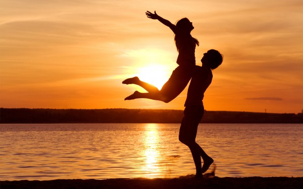 happy-couple-on-the-beach-at-sunset